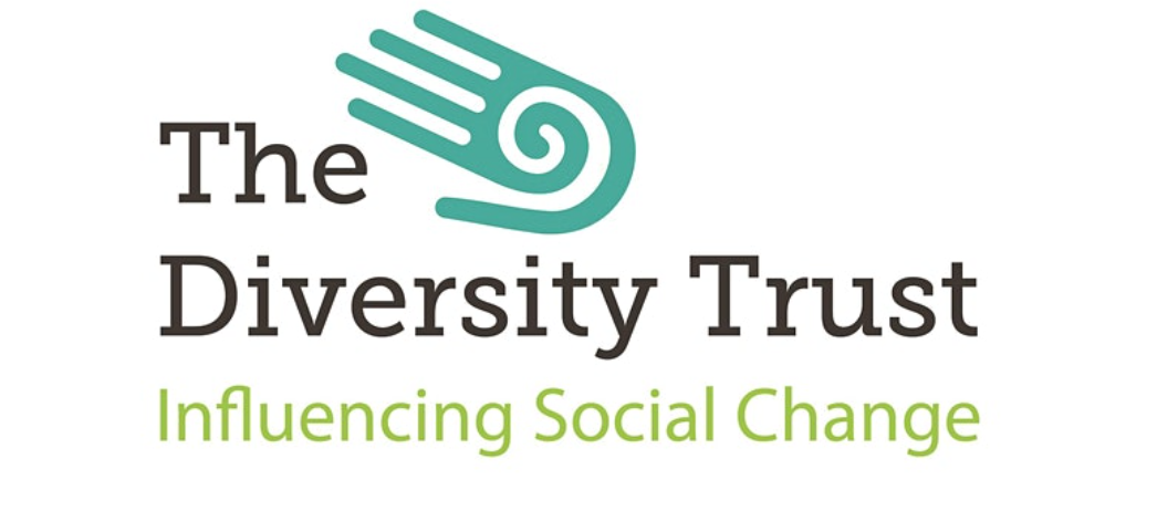 Logo of The Diversity Trust with green hand icon above black and green text
